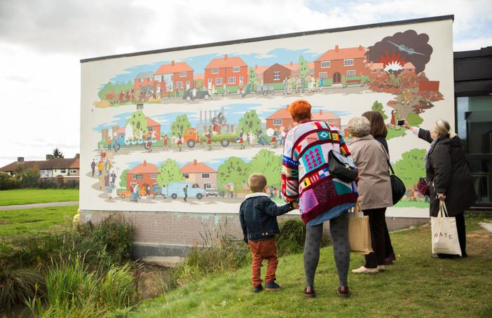 Visitors enoying the Becontree mural This Used to be Fields, a Creative Barking and Dagenham landmark commission with Create and Chad McCail. Photo Emil Charlaff