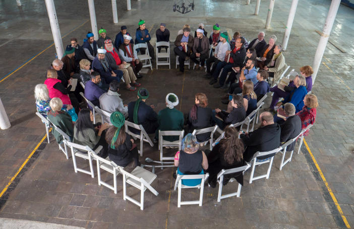 Sufi chanters, Shape Note singers and local residents come together to share in music and song in the disused Brierfield Mill in Pendle. Part of a three-day art film event Shapes of Water, Sounds of Hope, a collaboration between pioneer in public art Suzanne Lacy and arts collective In-Situ. Super Slow Way. Photo Graham Kay