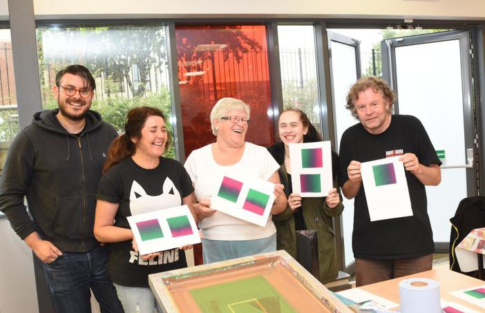 Participants in a screen printing workshop